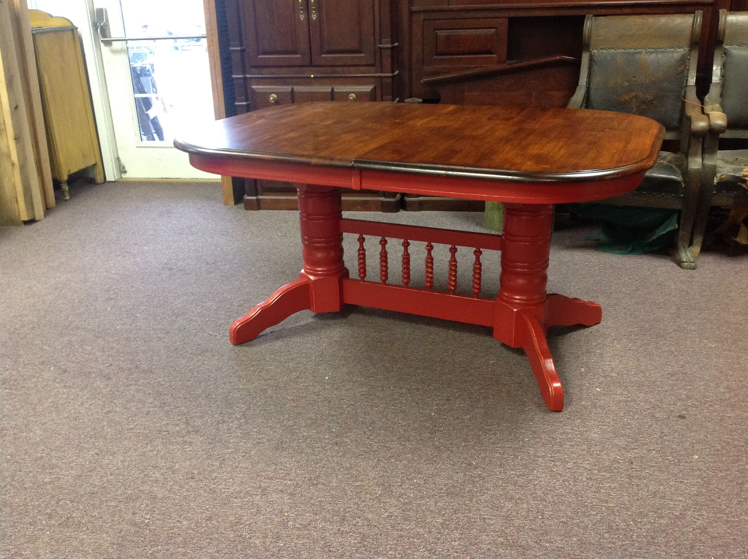 We completely redid this table! It was originally stained very light natural color and had a broken leg. We fixed the leg, painted the bottom and stained the top dark, it turned out beautiful!