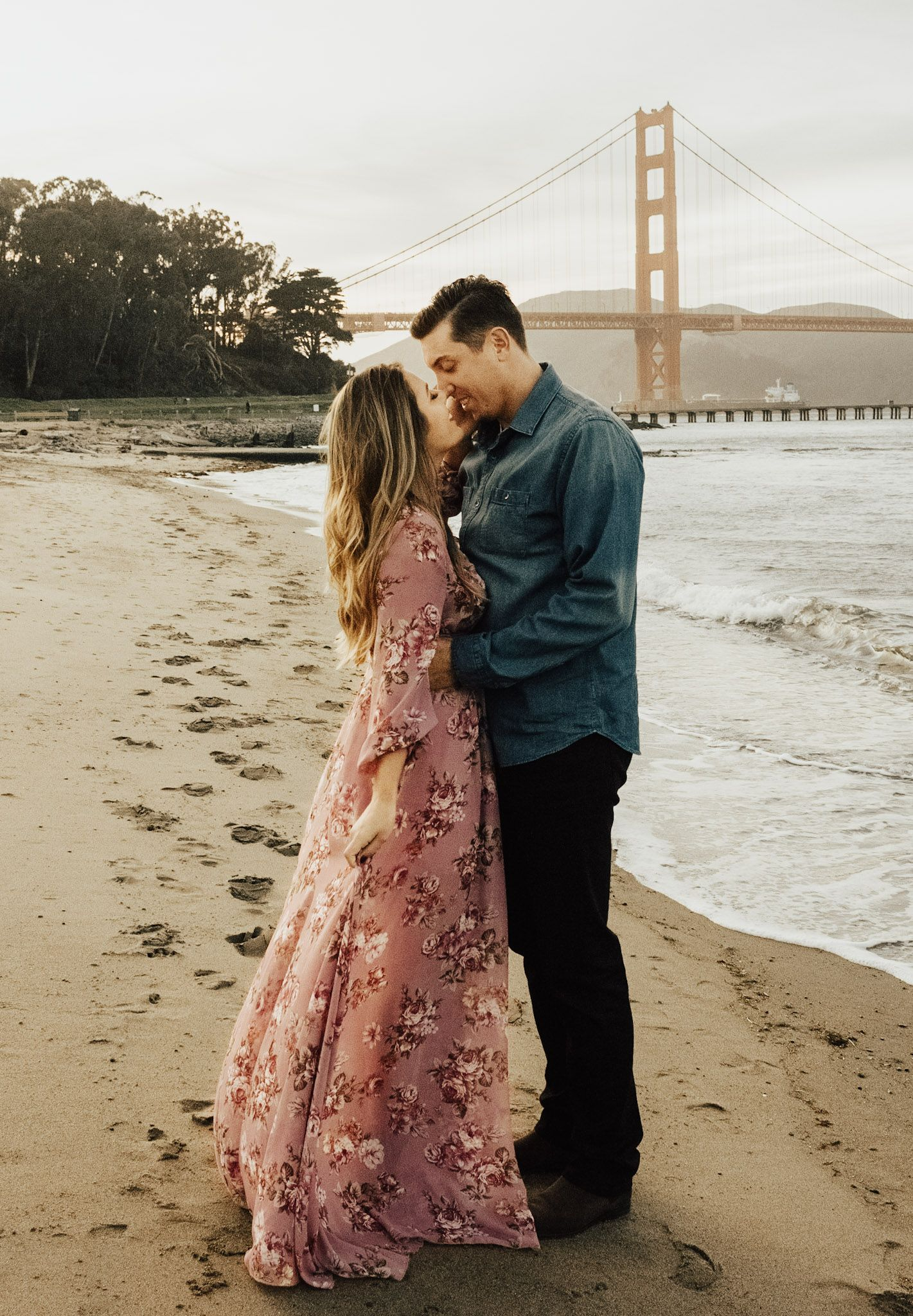 Photo Shoot In San Francisco Floral Maxi Dress Engagement Session Engagement Photo Outfit Lon Engagement Photoshoot Couple Outfits Couple Photography Poses [ 2048 x 1421 Pixel ]