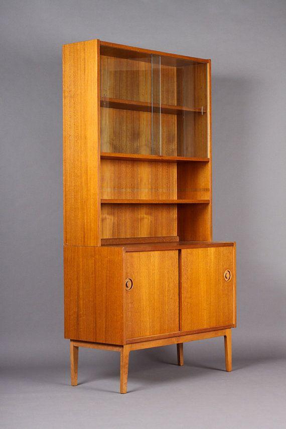 items similar to vintage danish modern mid century upright teak bookcase u2013 lower sliding door storage w shelves sliding glass display above u2013 two piece