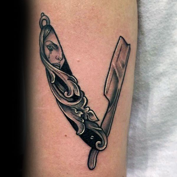 Tattoo Meaning Razor: Carved-tear-stained-face-of-young-girl-straight-razor