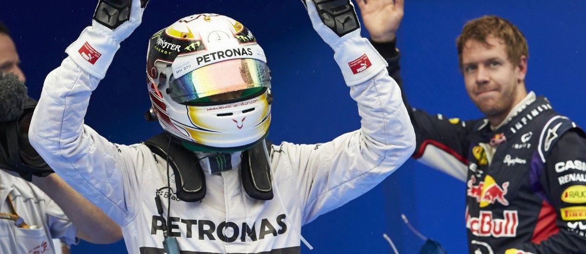 Hamilton edges Vettel to pole in soaked Sepang