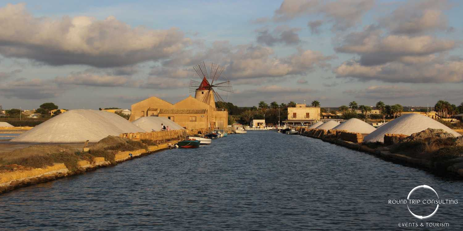 #Sicily: #Navigate to #Mothia from #Stagnone #Reserve and enjoy a surreal environment with sea salt fields and windmills!