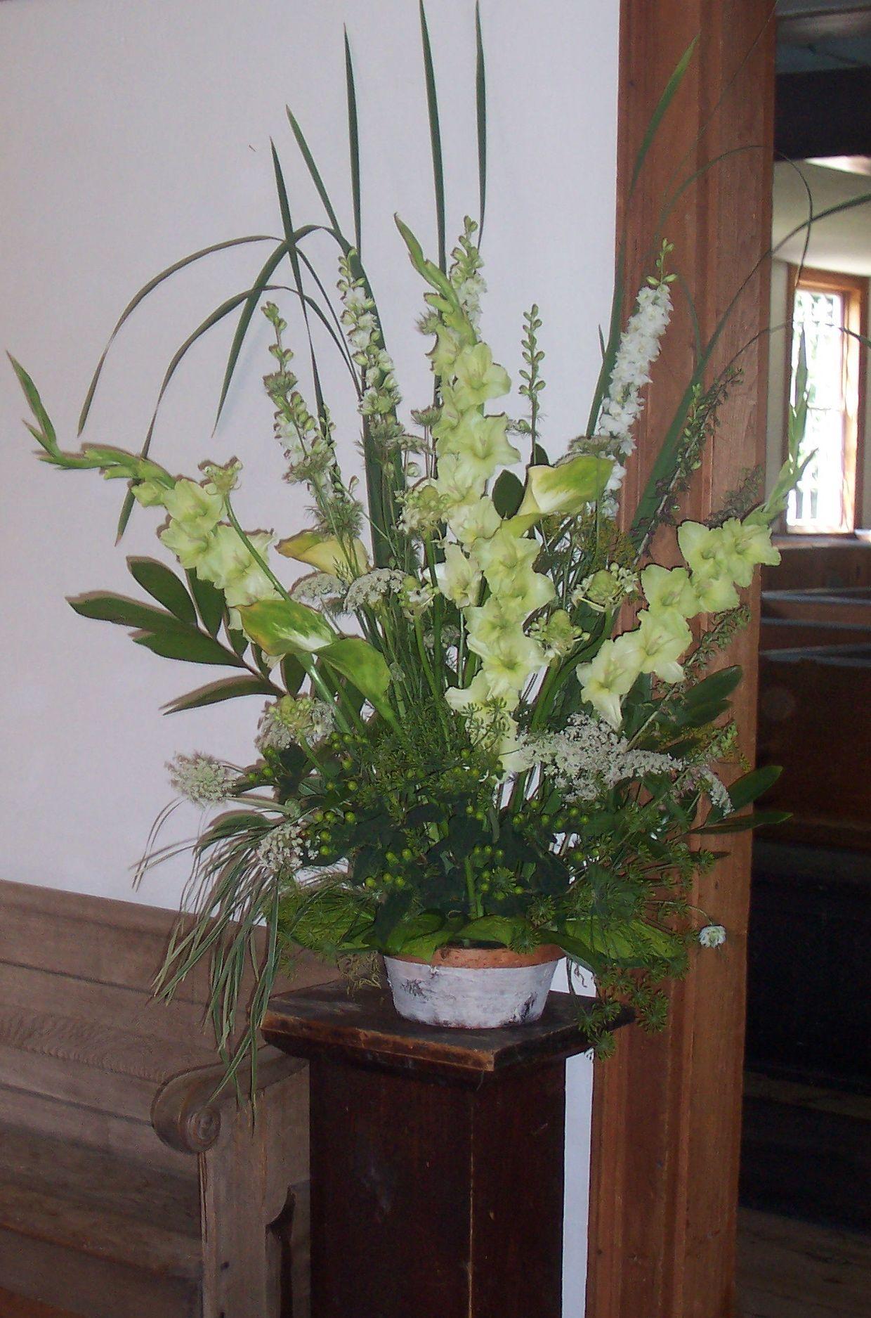 """green"" arrangement using grasses, gladiolas, callas, hypericum, queen anne's lace and larkspur"