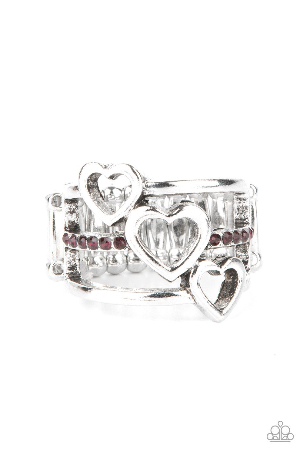 Infused with a row of glittery purple rhinestones, a trio of airy silver hearts slant across three silver bands that layer into a charming centerpiece atop the finger. Features a stretchy band for a flexible fit. Sold as one individual ring.