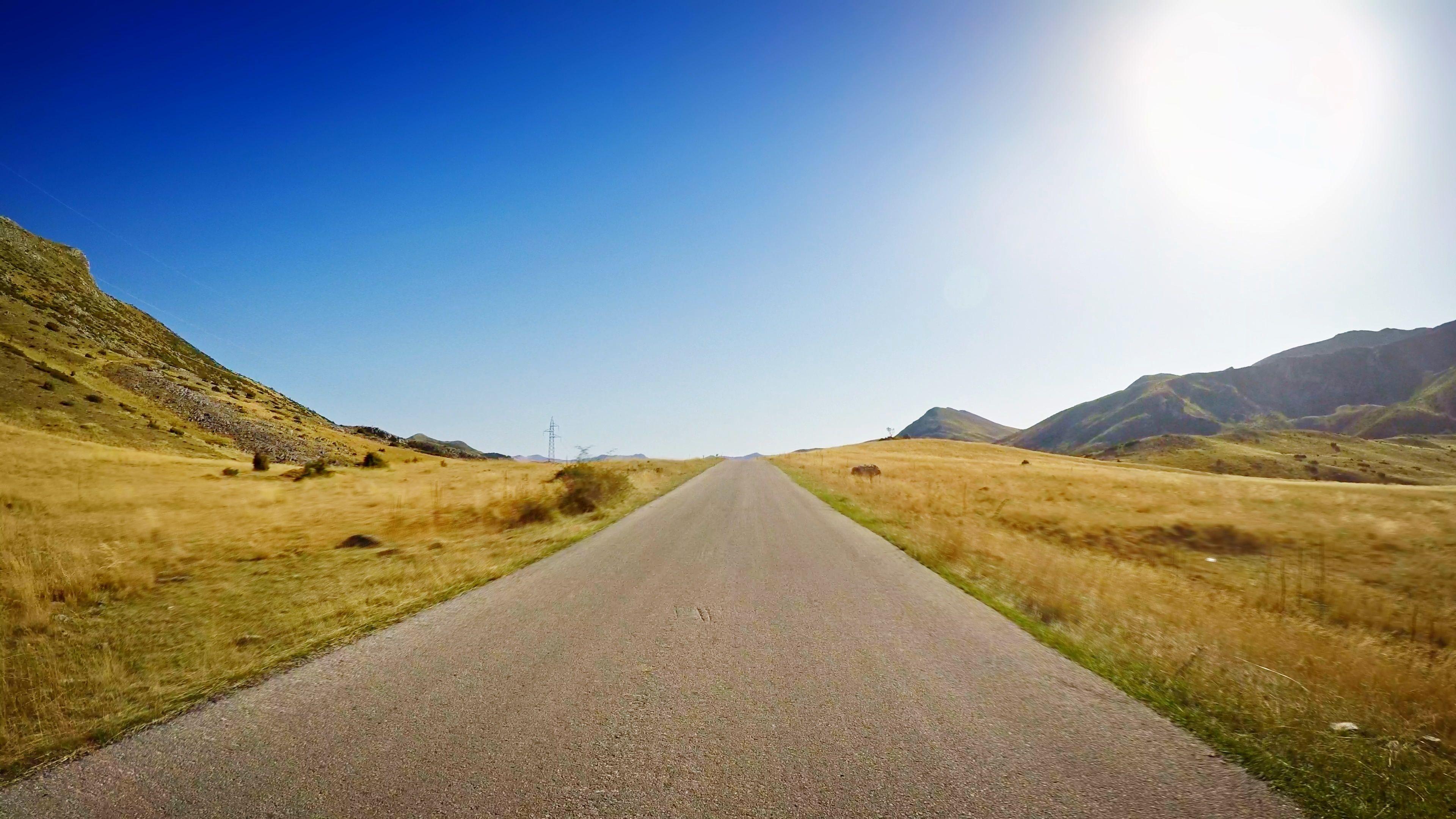 Pov drive upland countryside nature grassland shining sun