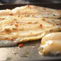 Smoking fish such as cod is an ancient practice of preserving it. Fresh fish goes bad after only a few days. By smoking the fish, it will last several weeks. Smoking adds flavor to the fish, depending on the wood and spices used. Using spice rubs, you can bring out the flavor of fish as it cooks. The type of wood you use will change the flavor and...