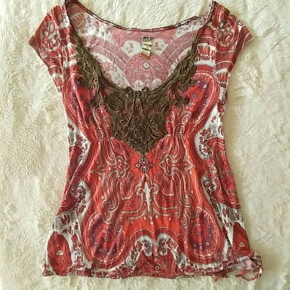 Free People tee Free People size large. Coral print with a brownish green woven pattern across the chest. Drawstring tie at the bottom. Excellent condition. Free People Tops Blouses