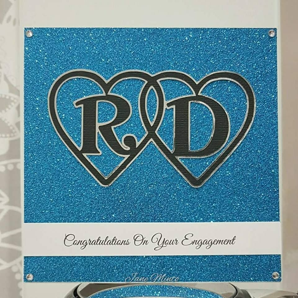 An engagement card for my brother in law, I designed the hearts with initials on the scan n cut. The sentiment was printed.
