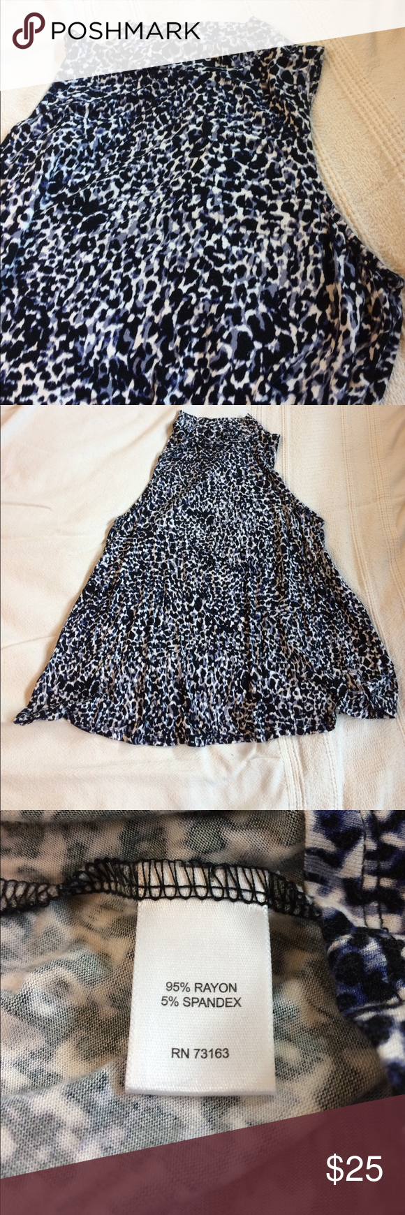 Tunic Tank with Mock Turtleneck Animal print in shades of black blue and white. Very swingy, drapey fabric is rayon with a bit of spandex. Mock turtleneck line. Sleeveless. Can be dressed up or down! Tops