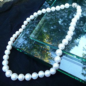 There's no match for the understated elegance of a single-strand white pearl necklace. Worn with a sundress at a summer wedding or a paired with sweater at a fall tailgate, this timeless accessory makes every Southern frock more chic.