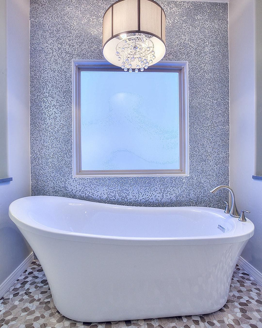 TileTuesday: Ground a modern freestanding tub with a pebbled floor ...