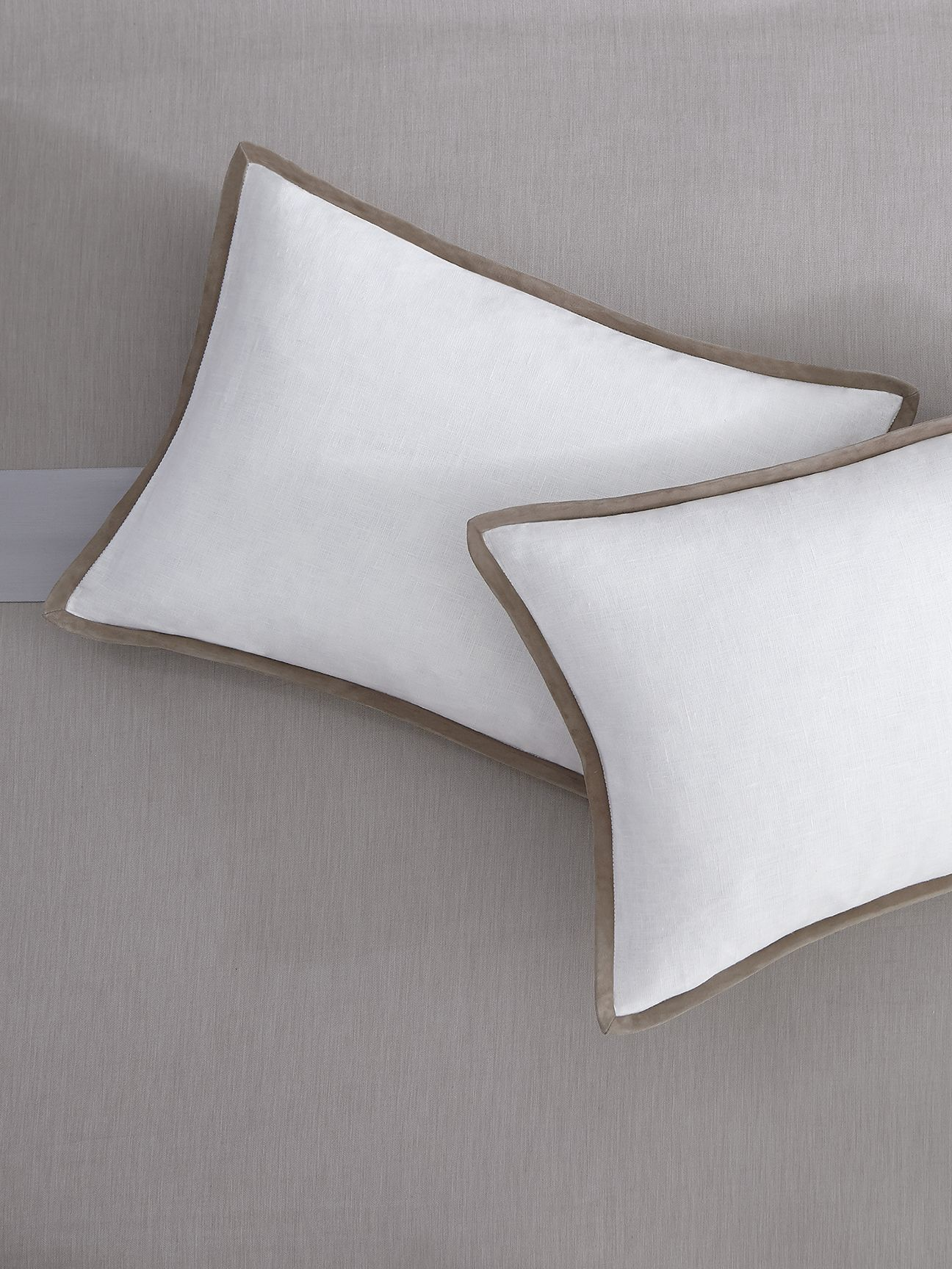Addia is reminiscent of elegant simplicity with its clean, off-white linen base framed with a velvety suede border. It's the ideal decorative pillow to accompany any design.