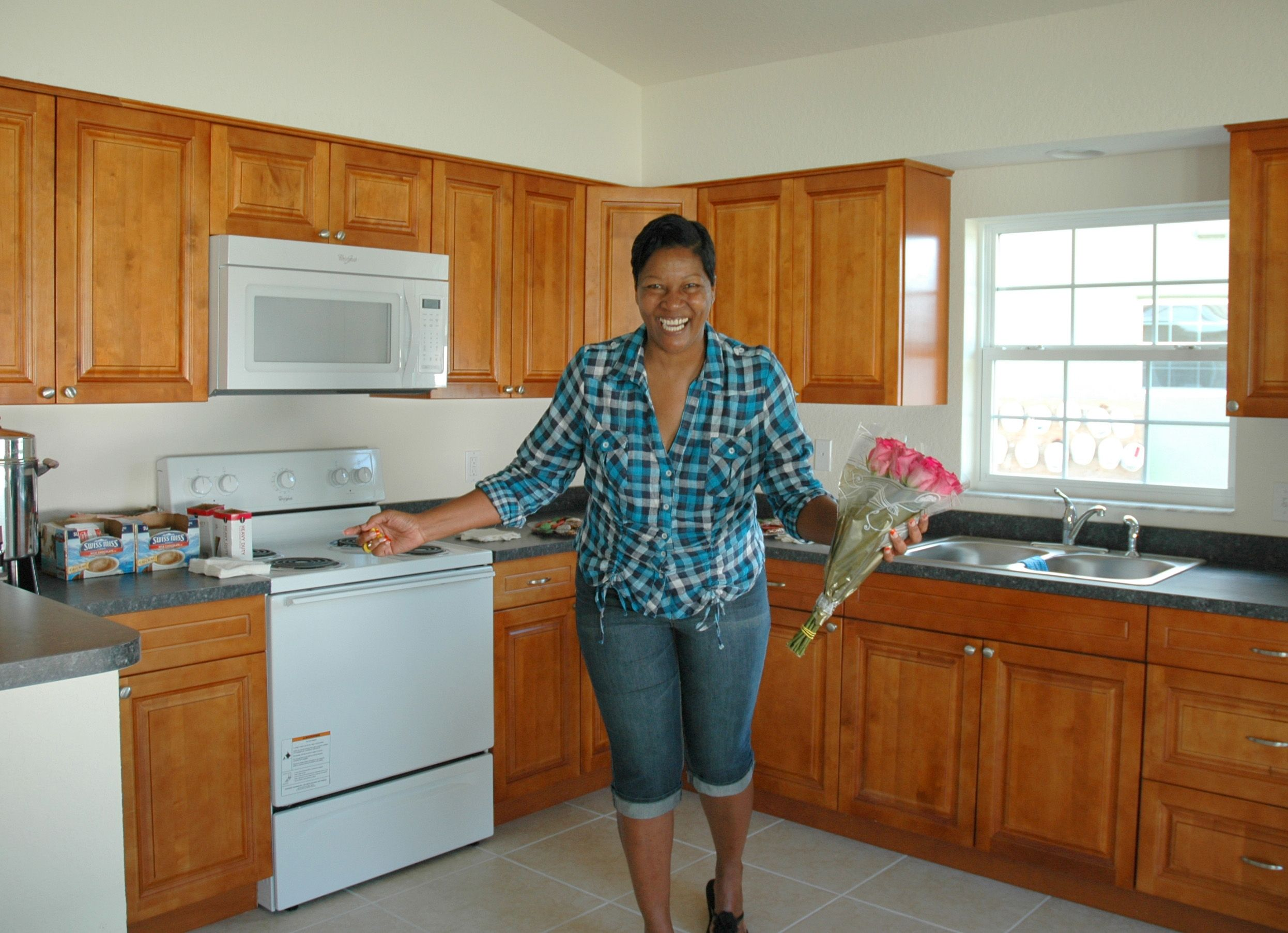 Tracy Stands In The Kitchen Of Her New Habitat Pinellas Home