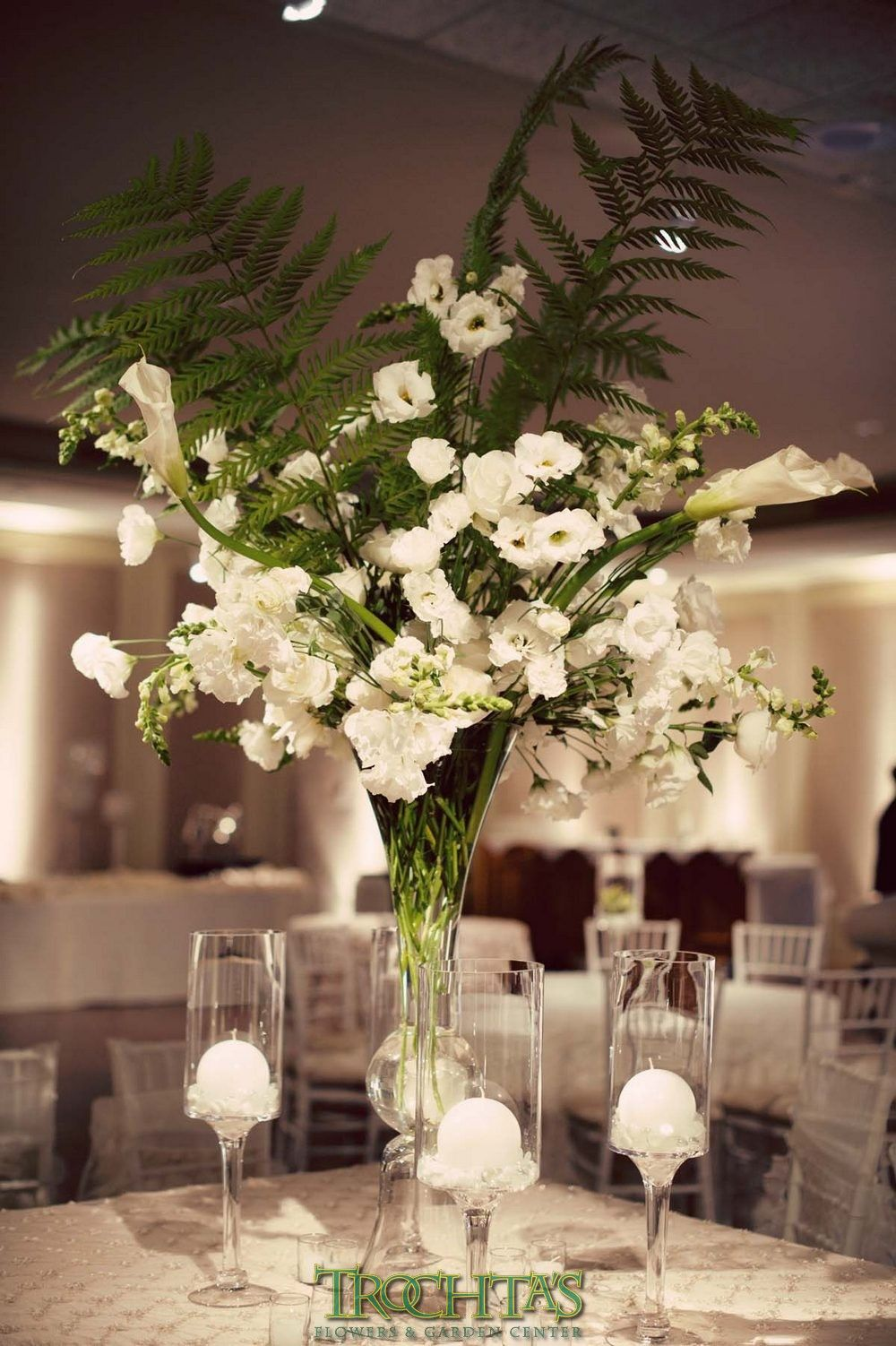 Tall white floral centerpieces with large fern leaves for for Floral arrangements for wedding reception centerpieces