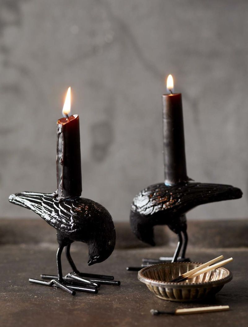 Midnight black raven taper candles add a dramatic note to your
