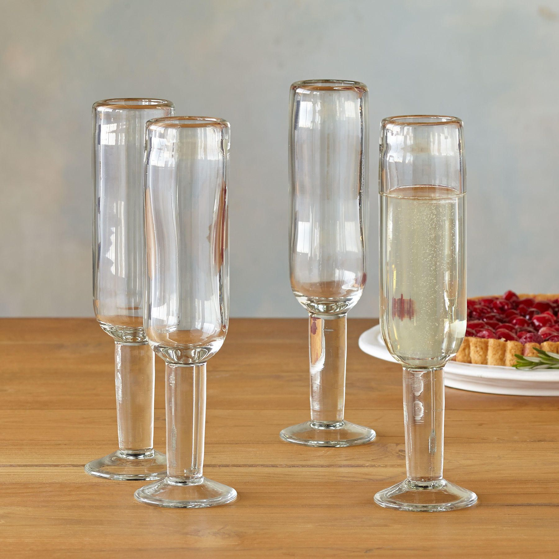 """DARBY CHAMPAGNE GLASSES, SET OF 4�--�Traditional handblown glass takes on modern dimensions in all-ocassion glassware that is as lovely to hold in hand as it is to look at. Holds approx. 5 ounces. Imported. 2-3/4"""" dia. x 8""""H, set of 4."""