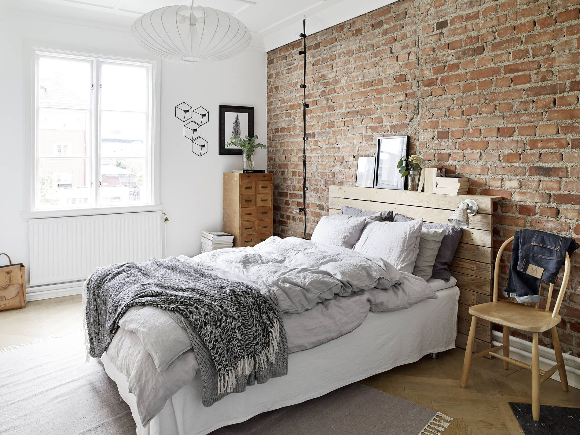 The Combination Of Exposed Brick And Soft White Walls Feels So Homely