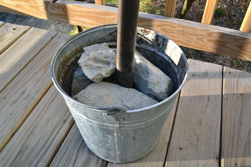 diy umbrella stand cement blocks in a bucket galvanized. Black Bedroom Furniture Sets. Home Design Ideas