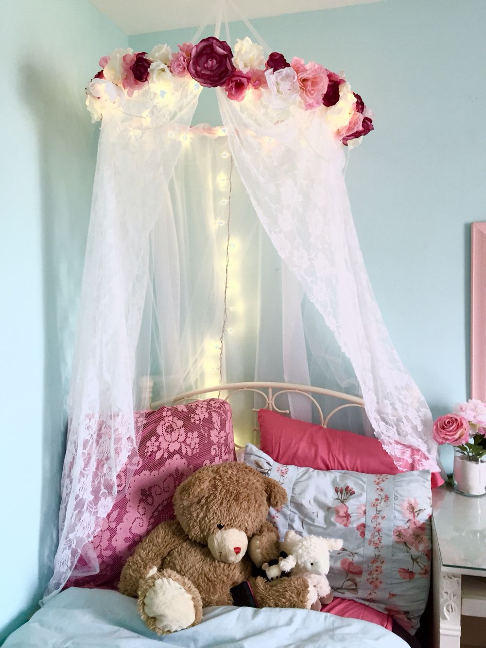 pink and blue girl's room with canopy and tree mural. tiny shabby