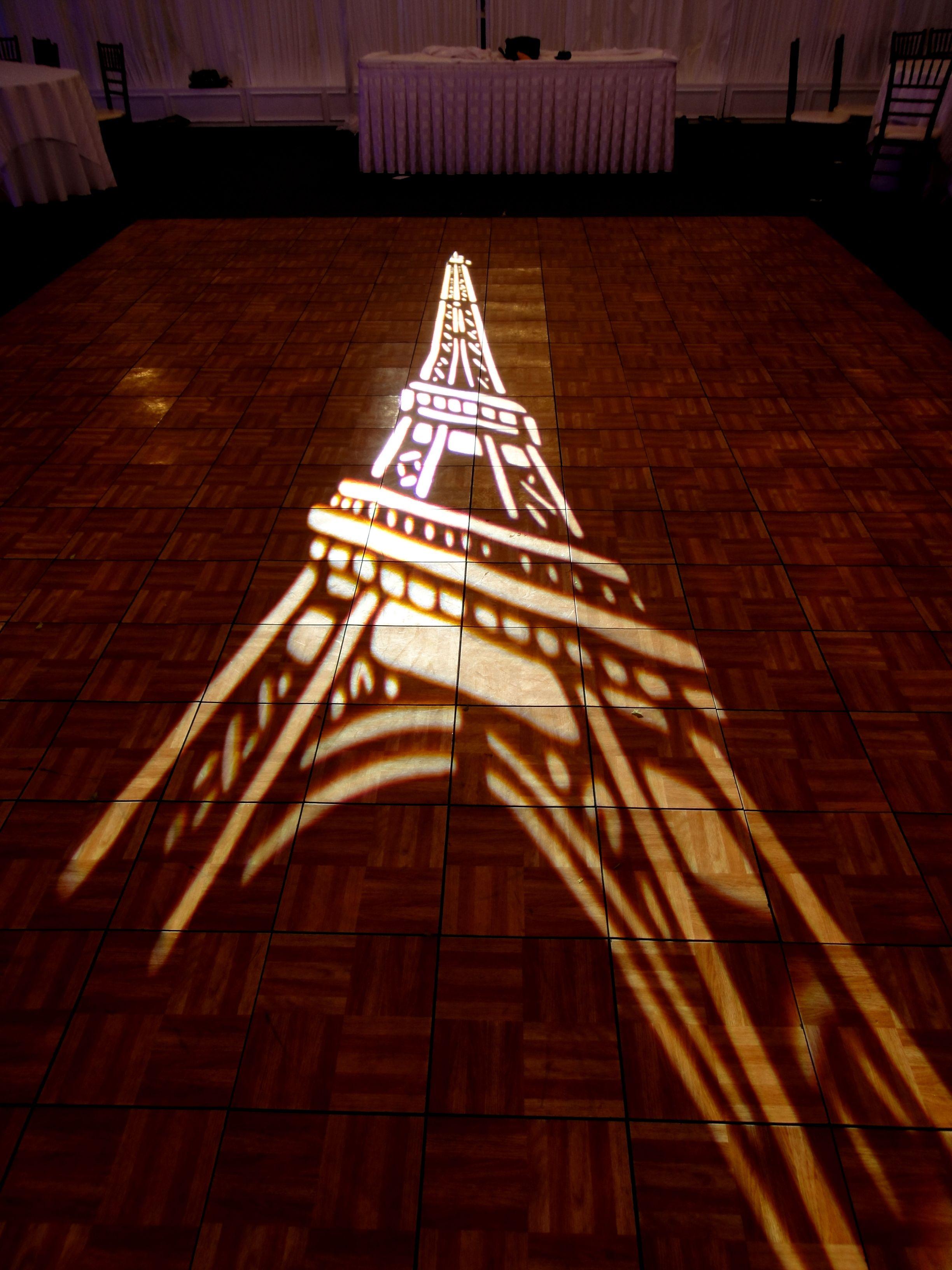 Parisian theme wedding with Eifel Tower gobo dance floor projection