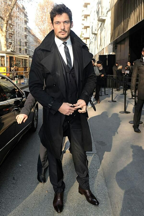 David Gandy in all black ensemble with long black coat ...