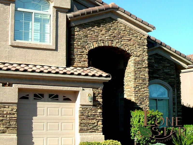 Exterior: Stacked Stone Veneer Entry And Garage Accents.