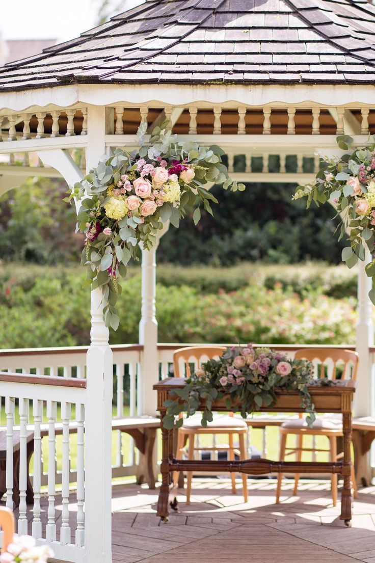 Wedding Gazebo Corner Floral Arrangements With Roses And Greenery