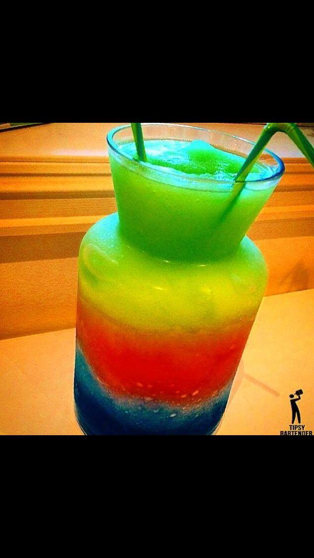 - blue layer -  Vodka Blue curaçao Lime juice - red layer - Strawberry daiquiri mix Malibu coconut rum - green layer - Banana liqueur Lemon balm Brazilian rum cachaca Sugar Like juice