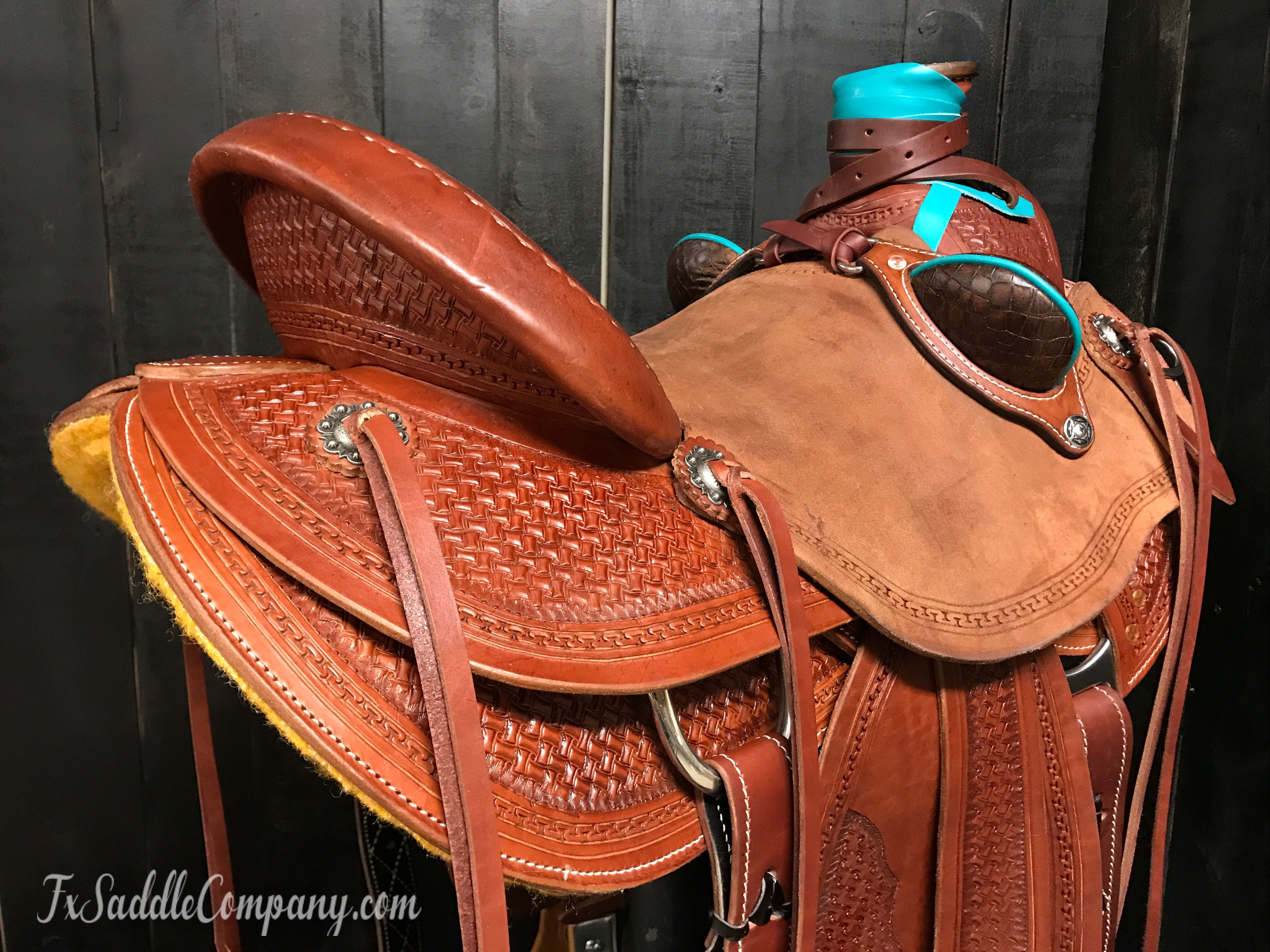 Wade saddle by FX Saddle Co  with turquoise horn wrap and