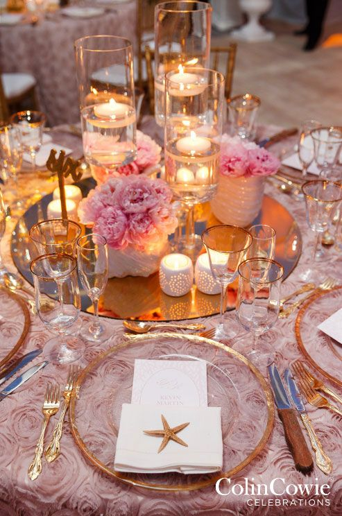 Floating Candle Centerpieces With Low Flower Arrangements And Votives On Mirror