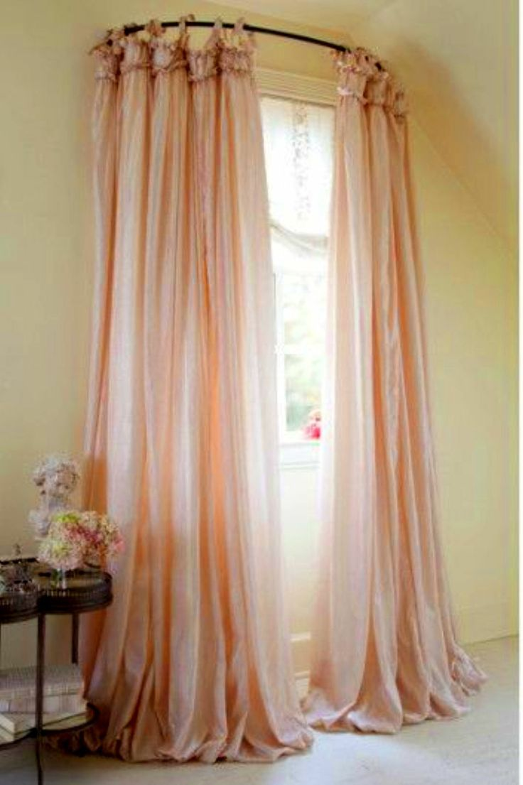curtain panels using a curved shower rod