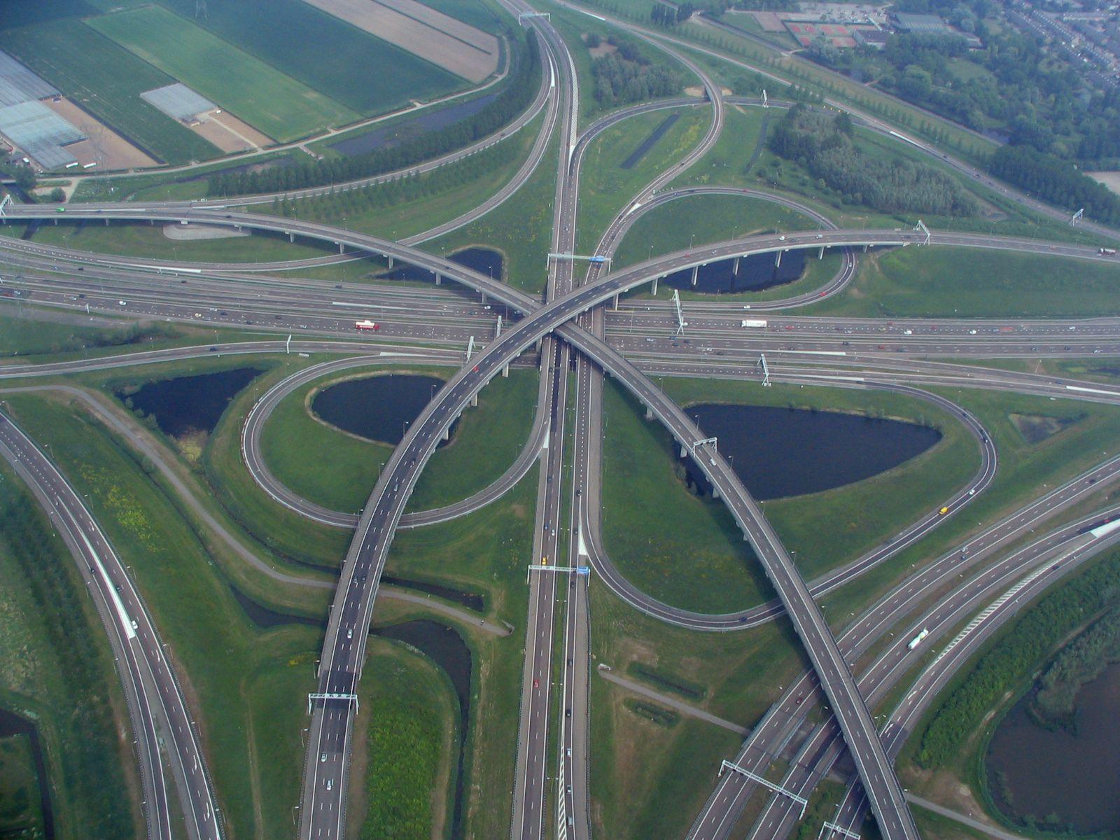 The Knooppunt Ridderkerk A Cloverstack Interchange Near Rotterdam 1600 X 1200 Beautiful Roads Road Signage City Skyline