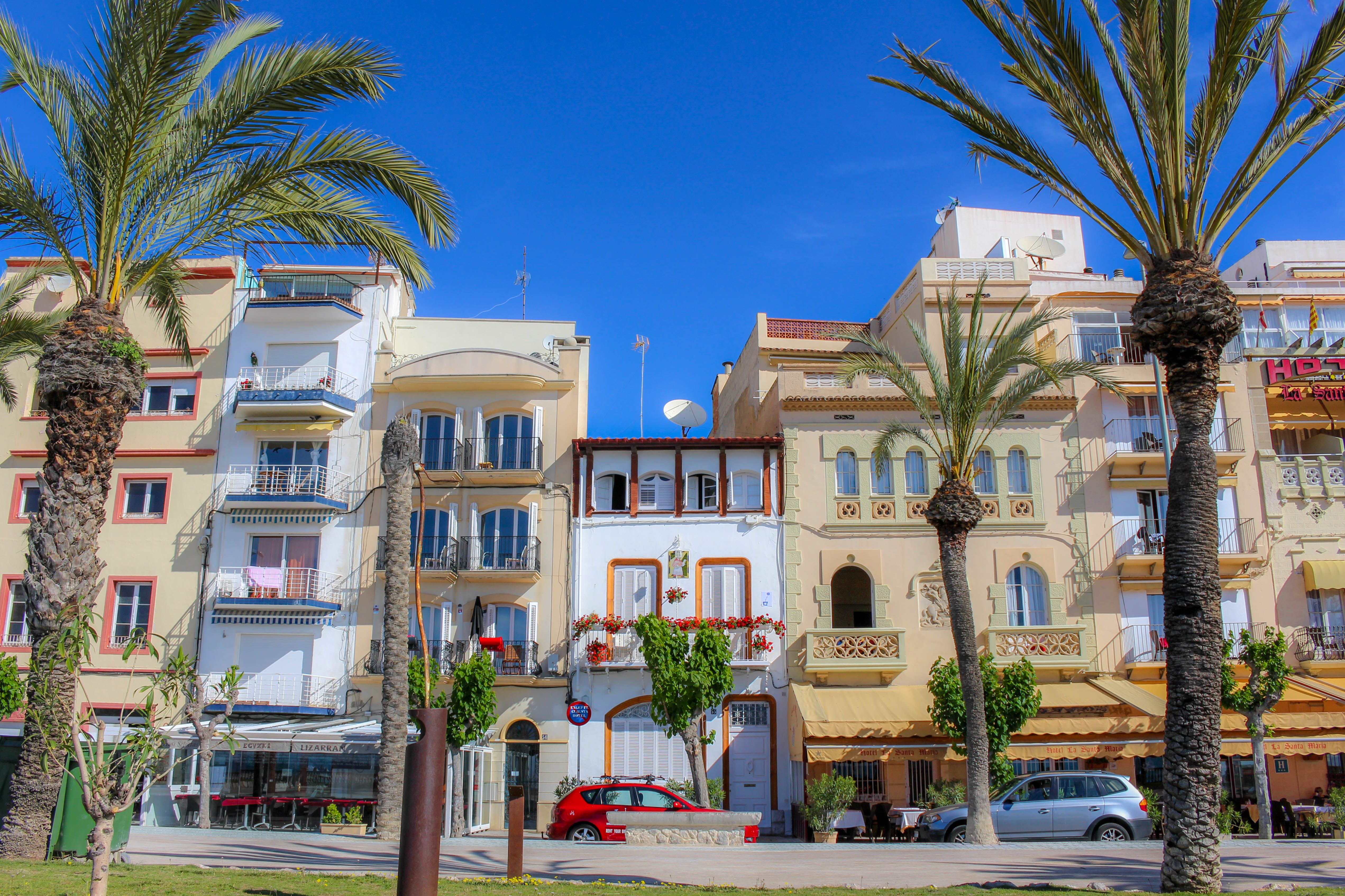 Compass + Twine | Gorgeous mansions line the beach front promenade in Sitges, Spain -- just 30 minutes from Barcelona!