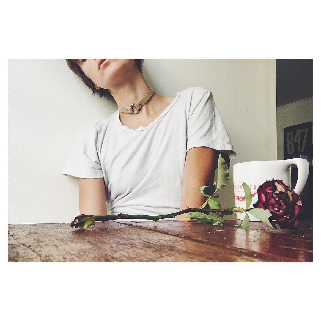 Sucking down coffee like its my job and lamenting the death of this rose #oops #badatplants #burymeinleather #jakimac