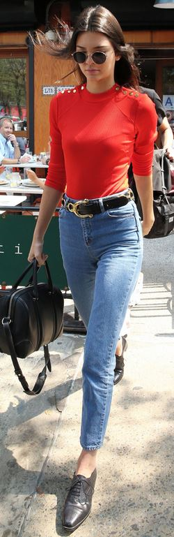 Who made Kendall Jenner's black handbag, sunglasses, blue jeans, and shoes?