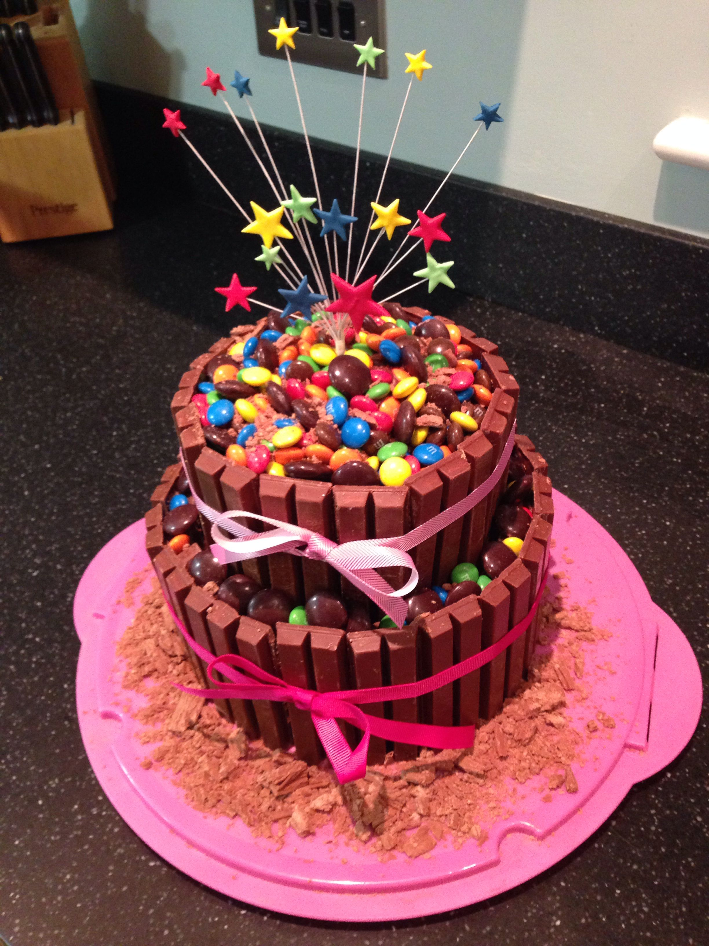Double Tier Kit Kat Cake With Multi Star Topper And Covered In