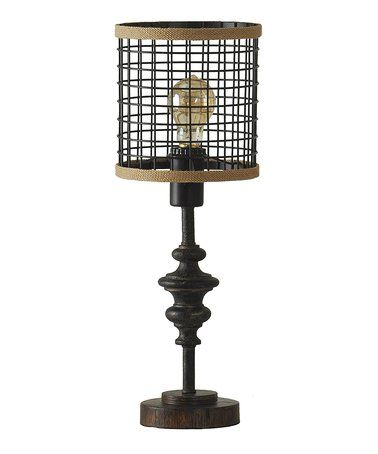 Invite a vintage inspired touch into your space with this lamp showing off a weathered wood exterior and an old world cage shade design