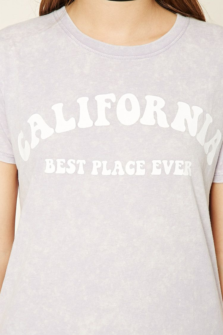 "A knit tee featuring a ""California Best Place Ever"" graphic on the front, an acid wash, a round neckline, and short sleeves."
