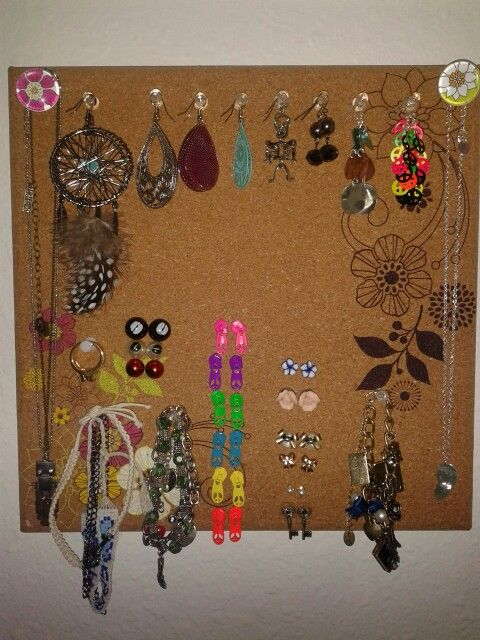 DIY jewlery holder with a cork board and push pins Make holes for