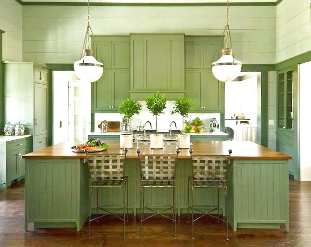 gorgeous-ceiling-lamps-above-wide-green-island-and-metal-stools ...