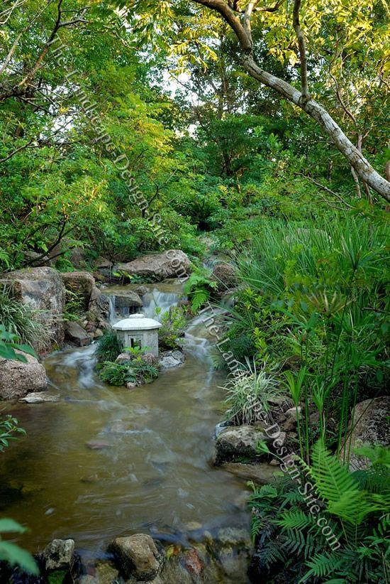 Small Pagoda In The Stream Garden Stream Japanese Garden Japanese Garden Design