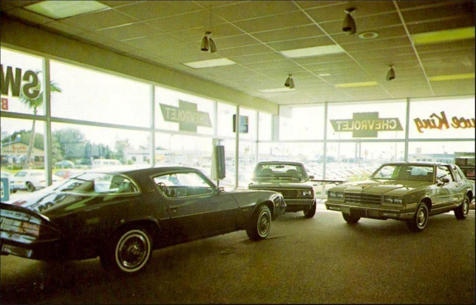 (16) Vintage Automobile Dealerships and Automobilia