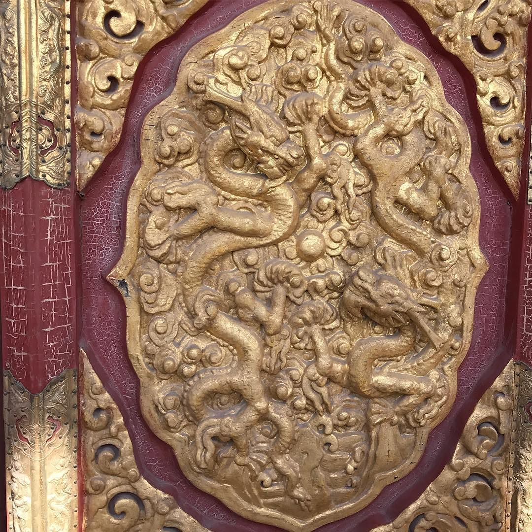 This carved wooden door with goldleaf looks like it could be the