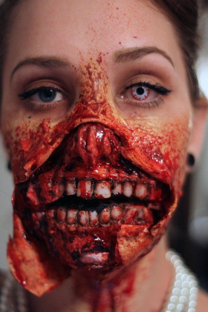 Awesome zombie cosplay girl with ripped open mouth