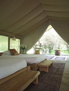 love the wooden furniture and the color scheme!  The Luxury Naibor Private Retreat in Kenya