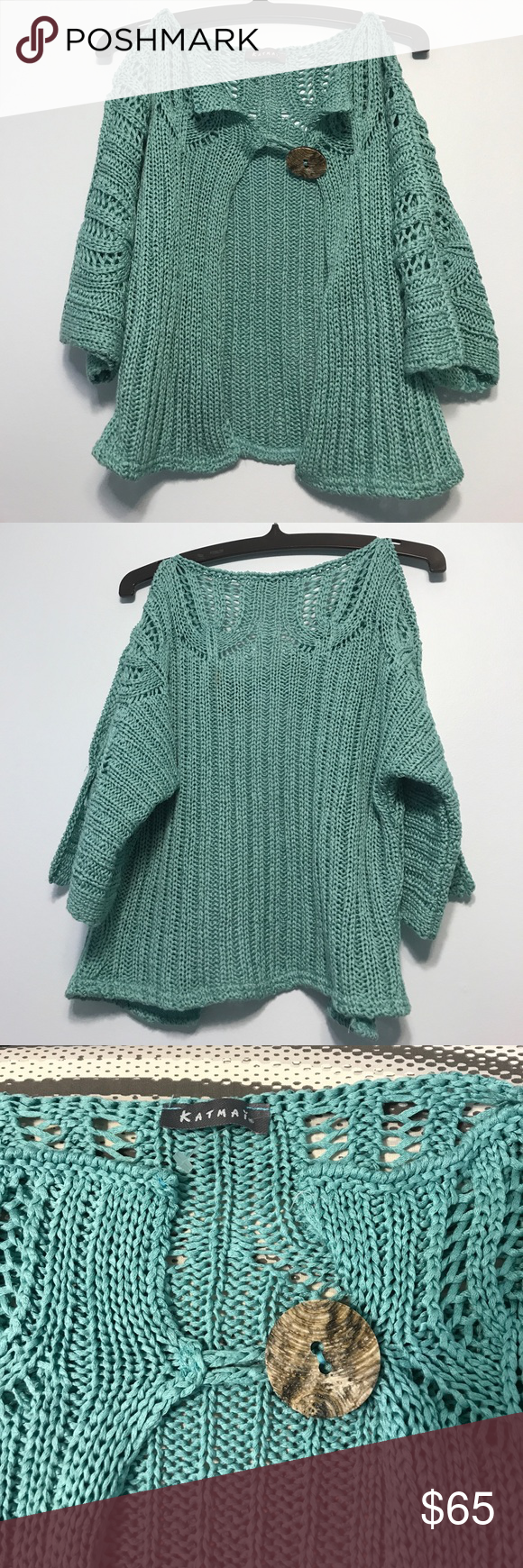 KATMAI aqua knit sweater. Size xs. Fresh and fun loosely fitted aqua knitted sweater with a large wooden button to top off the look :) Worn once. Has a little stain that's not very visible - picture of stain is attached ( you might have trouble pinpointing the stain :)) katmai Sweaters