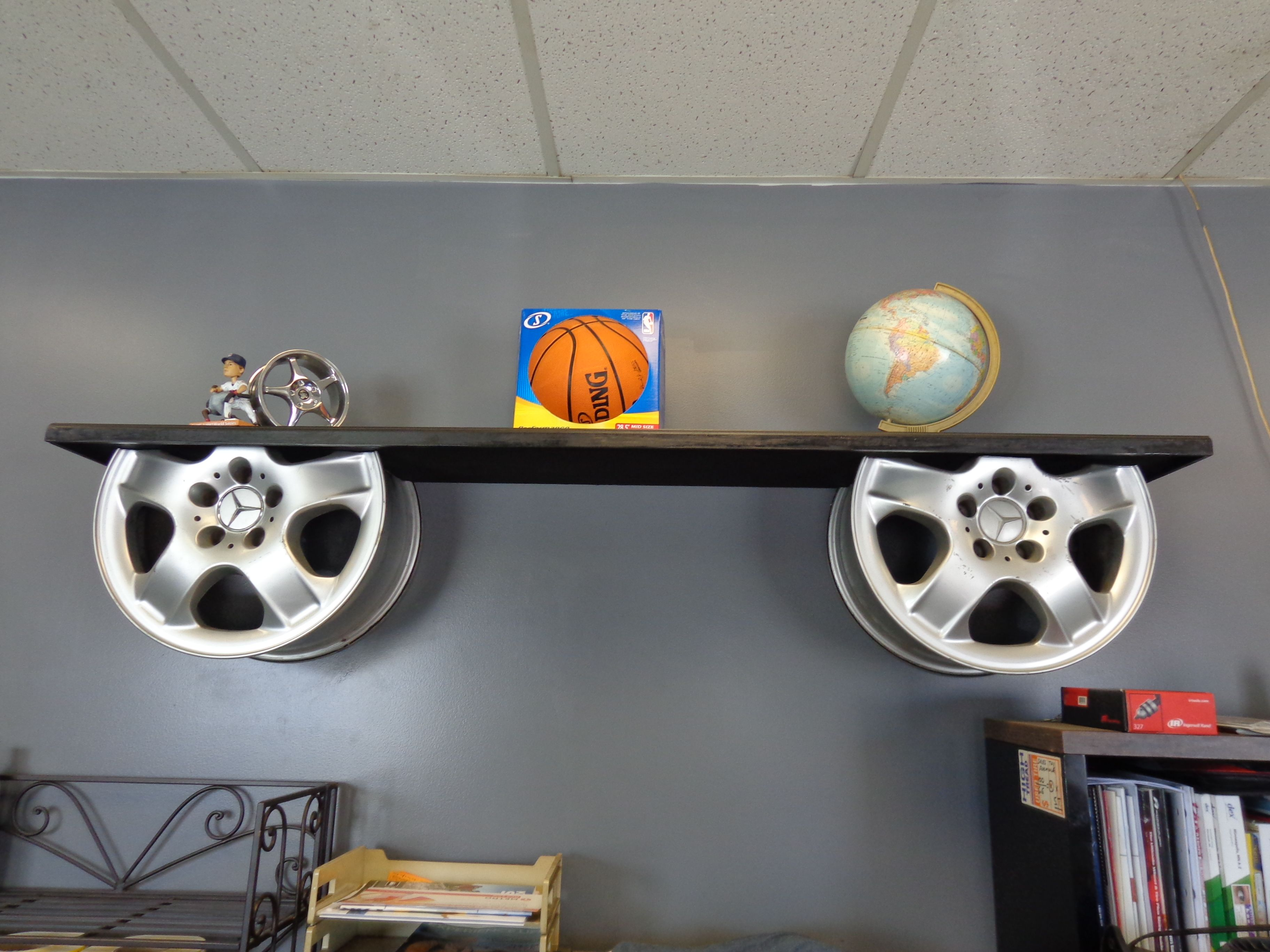 A Simple Auto Decor Themed Shelf Made Out Of Wheels While Not Tire Repurposing Its Still In The Car And Scheme