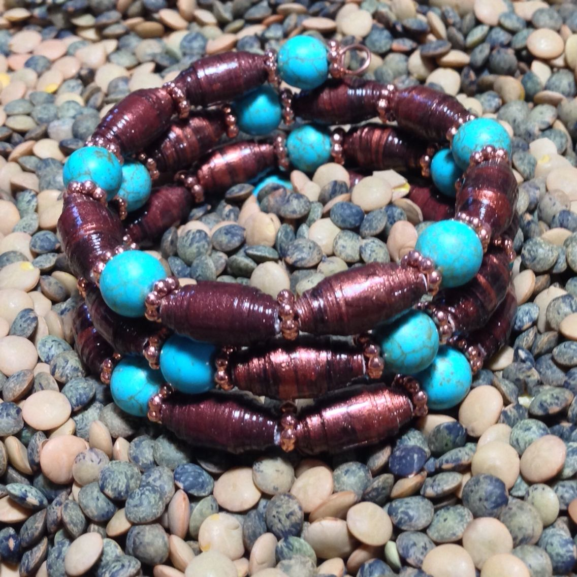 Triple loop memory wire bracelet made with hand painted paper beads and turquoise.