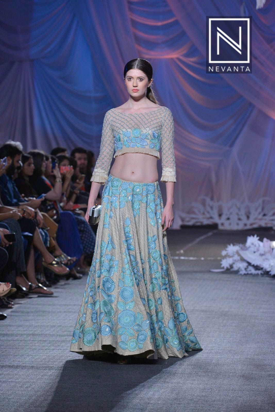 A structured lehenga and blouse perfect for summer weddings by ...