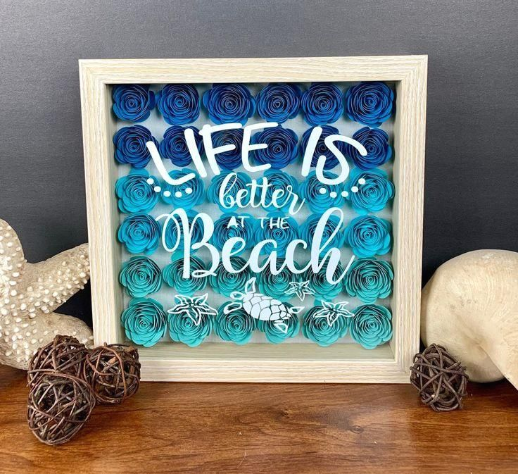 Beach shadow box, Beach decorations, Shadow box, Beach home decor, summer decoration, Seashore decor, Summer shadow box, water decor   This Beach Shadow box will look great with your decorating for The beach, the flowers are hand rolled in three different colors of blue ombré in heavy card stock,